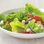 Colourful salad with cheese dressing